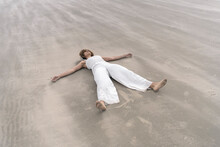 Black Woman Lying On The Beach