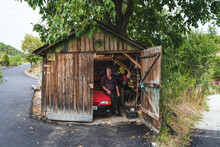 An Old Man In His Wooden Garage