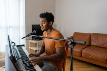 Musician Playing Piano And Singing At Home