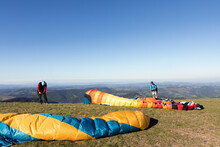 Paragliders Getting Ready For A Flight