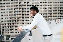 A Beautiful Portrait Of A Young Black Man Dressed In All White