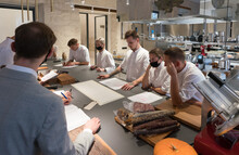 Meeting Of Cooks In Modern Kitchen