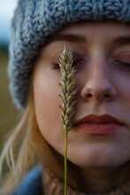 Woman Touching Face With Spikelet