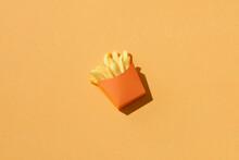 French Fries In A Paper Cup On A Color Background