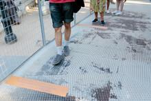 People Standing In Line Keeping Distance Due To Coronavirus Measures