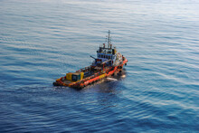 Anchor Handling Tug Utility Boat At Open Sea And At Offshore Oil And Gas Field.