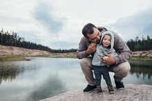 Father And Little Son At The Lake