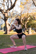 Fit Woman Training In The Park
