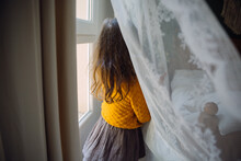 A Girl By The Window