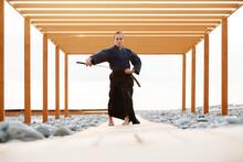 Barefoot Samurai Taking Sword From Scabbard