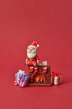 Plasticine Santa Claus Sitting On Fireplace With Gifts.