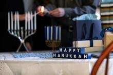Hanukkah: Blocks With Holiday Message In Front Of Menorah Lighti