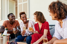 Smiling Friends Drink Champagne Together Outside