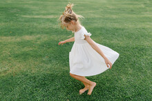 Girl Twirling On The Lawn