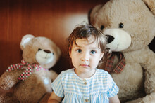 Toddler Surrounded By Teddy Bears