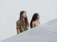 Portrait Of Couple Behind Diagonal Grey Stone