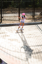 Young Girl With Skateboard