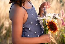 Girl In Blue Sundress Holding Flowers