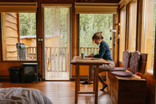 Woman In A Cabin Lodge