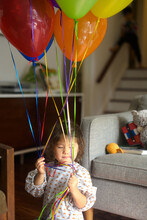 Child With Birthday Balloons
