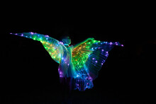 Night Photo Of Girl In Light-up LED Wing Costume