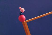 Four Color Spheres Balance On Wooden Frame