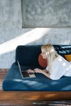 Blond Female Browsing Social Media On Laptop