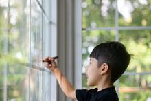 Little Kid Drawing On Windows