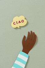 Raised Arms Near Hello Word Speech Bubbles In Italian Make By Paper.