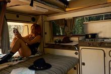 Wanderlust Girl Reading Inside A Old Camper Van
