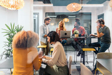 Coworkers Chatting During Coffee Break