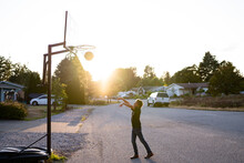 Boy Sinks Basketball Shot In Neighborhood Hoop