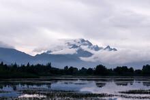 Yunlong Snow Mountain In The Cloud, Near The Lake Of Lijiang, Yunnan Province