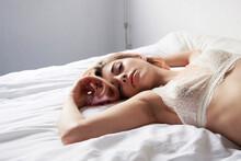 Teen Lying On Bed