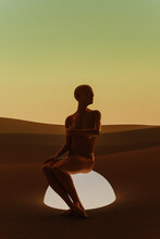 Woman Waiting In The Desert.