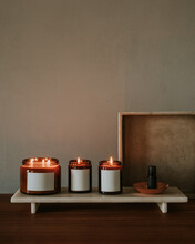 Lit Candles And Essential Oils In A Studio