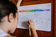 Kid Writing On Handmade Month Calendar