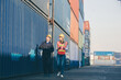 working engineer in the construction container yard. worker and supervisor checking containers data. Container Shipping Logistics Engineering concept