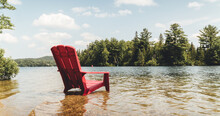 Red Chair Lounging In The Lake