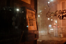 Old Phone Booth In Dark Street At Night