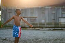 Boy In Swimsuit Swinging Arms