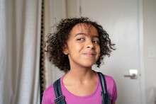 Girl With Short Curly Hair Looking Proud