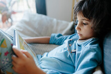 Kid Watching Cartoons On Ipad