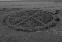 A Peace Sigh On A Sand