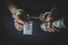 Drug Dealer Under Arrest Confined With Handcuffs.   Anti Drug.  Drug Concept.