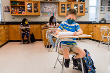 Kids With Masks In A Science Class