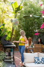 Woman Grills For Friends