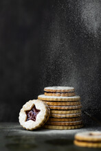 Christmas Linzer Cookies With A Dusting Of Confectioner's Sugar