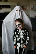 Happy Kids In Halloween Costumes At Home