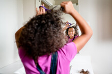 Laughing Girl Chops Hair With Scissors In Bathroom Mirror